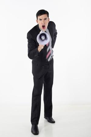 Businessman shouting through megaphone Stock Photo - 9288205