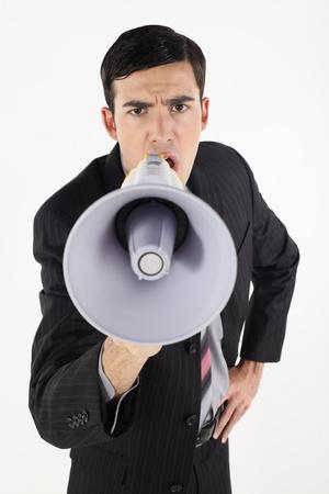 Businessman shouting through megaphone Stock Photo - 9288435
