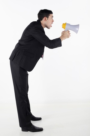 Businessman shouting through megaphone photo