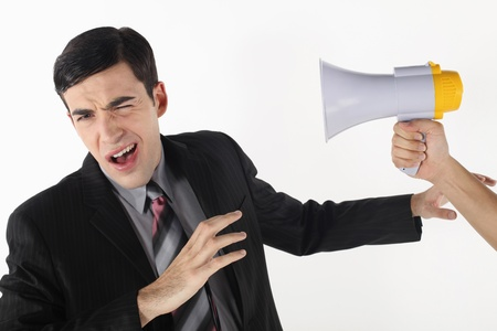 Businessman being shouted at through a megaphone photo