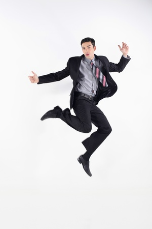 Businessman jumping in the air Banco de Imagens
