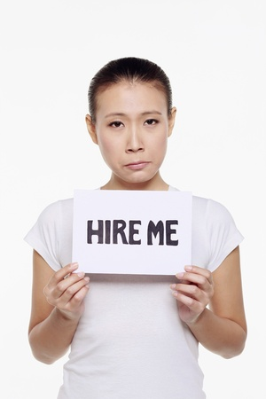 Woman holding a hire me sign photo