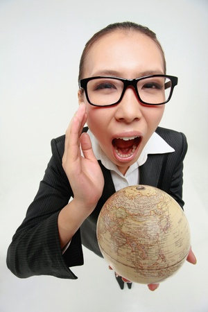 Businesswoman holding a globe and shouting Stock Photo - 9288801