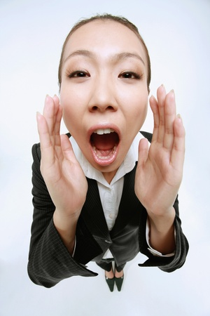 Businesswoman shouting out loud photo