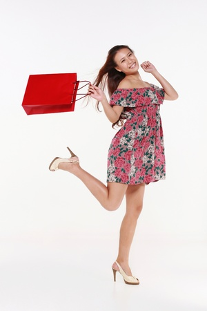 happily: Woman skipping happily after shopping Stock Photo