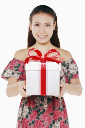 Woman with a box of wrapped gift photo