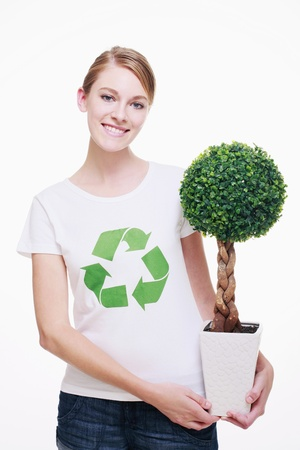 Woman with recycling symbol on her T-shirt holding a potted plant Stock Photo - 9521110