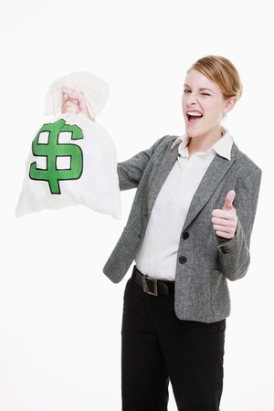 winking: Businesswoman holding a money bag and showing thumbs up Stock Photo