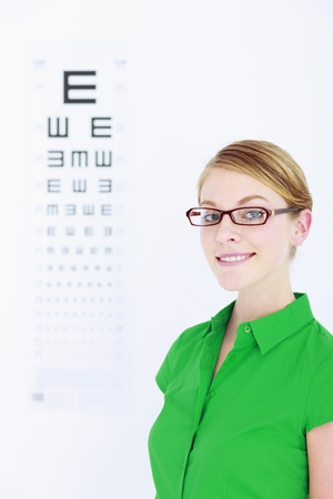 Businesswoman with glasses, eye chart in the background photo