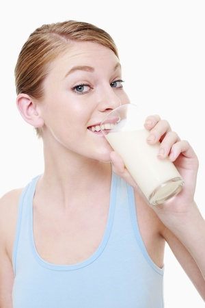 Woman drinking a glass of milk photo