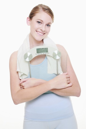 Woman holding weight scale photo