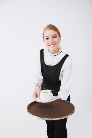 Waitress with a cup of coffee on tray photo