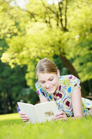Woman reading book in the park photo