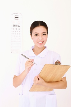 Optometrist writing on clipboard photo