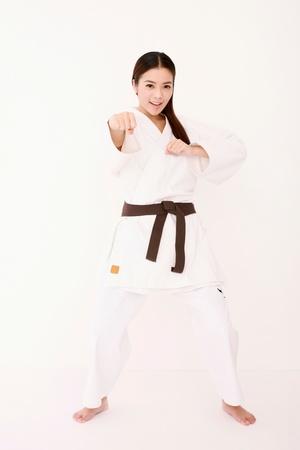 Woman in karate uniform photo