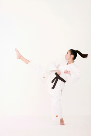 agility people: Woman in karate uniform