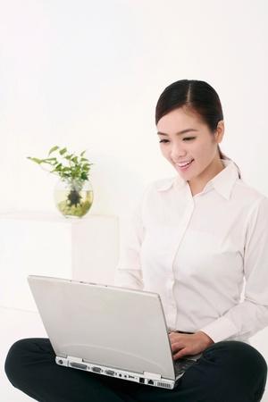 Businesswoman using laptop Stock Photo - 9521149