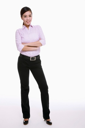 Businesswoman standing with her arms folded photo