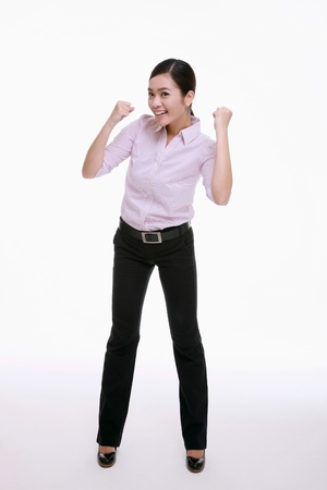 Businesswoman punching fists in the air Stock Photo - 9520789