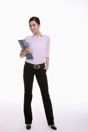 Businesswoman holding a file photo
