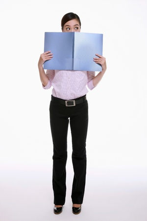 Businesswoman covering her mouth with a file Stock Photo - 9521002