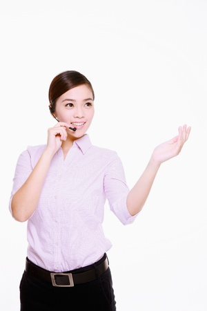 Businesswoman talking on telephone headset with her arm outstretched Stock Photo - 9521083