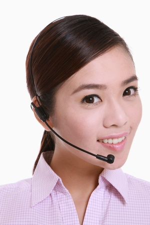 Businesswoman talking on telephone headset  photo