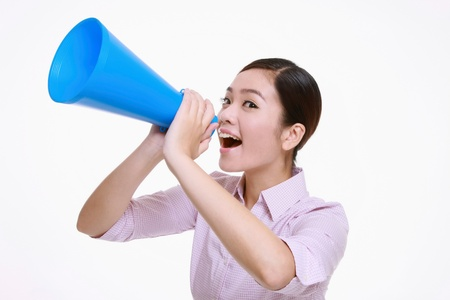 Businesswoman shouting through a megaphone photo