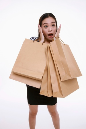 Woman with a lot of shopping bags photo