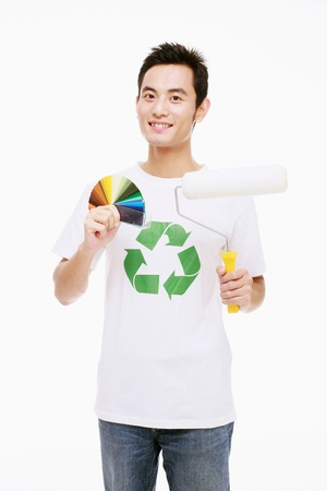 Man holding paint roller and color swatch Stock Photo - 9520848