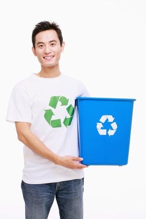 Man holding recycling bin Stock Photo - 9521013
