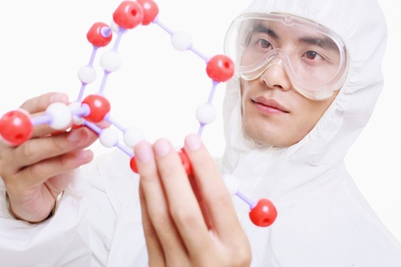 Scientist holding molecule photo