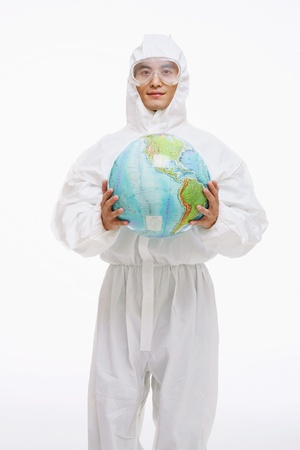 Scientist in protective suit holding globe Stock Photo - 9520746