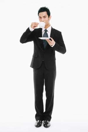 Businessman drinking coffee photo