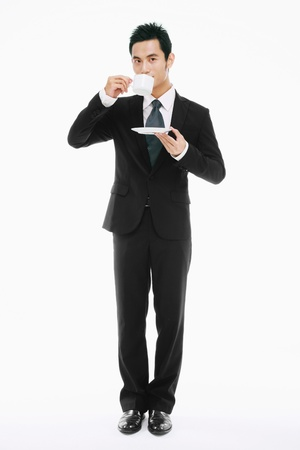 Businessman drinking coffee photo