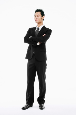 Businessman standing with his arms folded       Stock Photo - 9520530