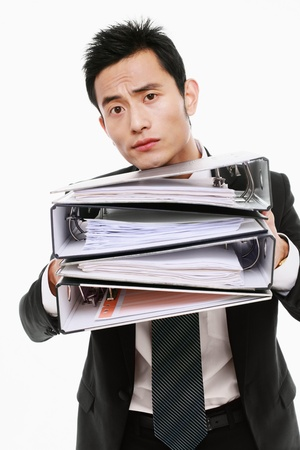 Businessman with a stack of files photo