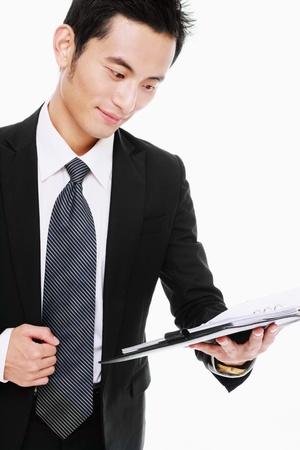 Businessman checking his organizer Stock Photo - 9521103