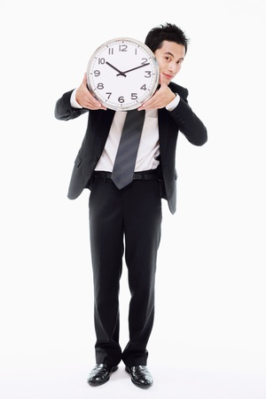 Businessman holding clock Stock Photo - 9521588