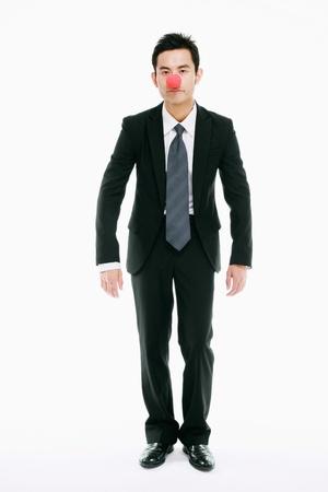 nariz roja: Hombre de negocios con la nariz roja Foto de archivo