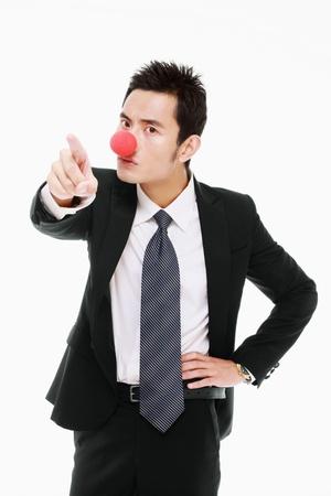 nariz roja: Empresario con nariz roja apuntando y rega�os