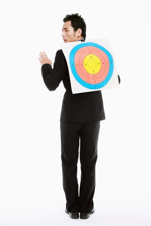 office politics: Businessman with target on his back