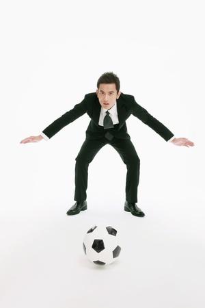 Businessman playing goalkeeper photo
