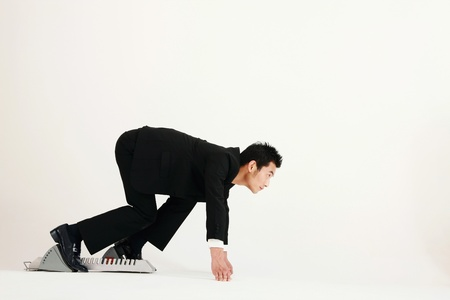 crouching: Businessman on starting block