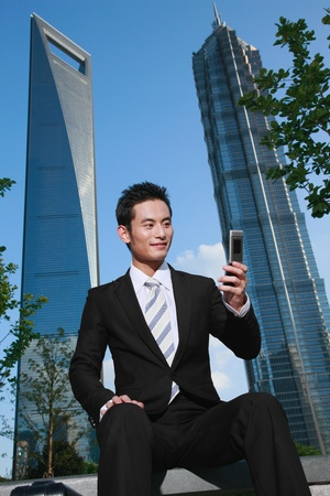 Businessman video calling on mobile smart phone photo
