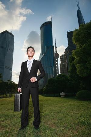 Businessman carrying a bag Stock Photo - 9521301