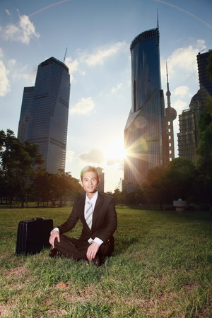 Businessman relaxing in the park Stock Photo - 9521302
