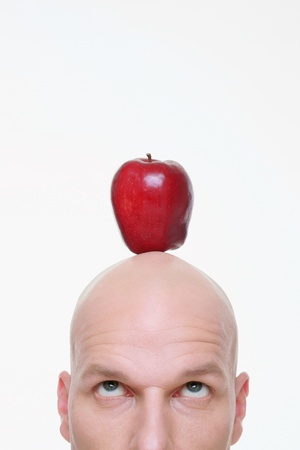 Man looking up at apple on the top of his head Stock Photo - 9525556