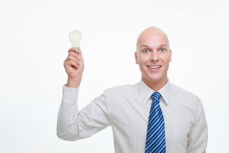Businessman holding up a lightbulb photo