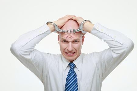Businessman being handcuffed Stock Photo - 9525672
